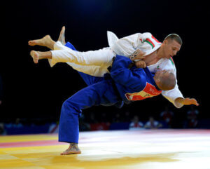 England's Danny Williams (blue) throws Connor Ireland of Wales as Williams wins his 73kG Preliminary Round in the Judo at the SECC during the 2014 Commonwealth Games in Glasgow. PRESS ASSOCIATION Photo. Picture date: Friday July 25, 2014. See PA story COMMONWEALTH Judo. Photo credit should read: John Giles/PA Wire. RESTICTIONS: Editorial use only. No commercial use. No video emulation.